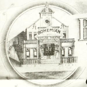 Two small shops flanked the entrance to the Bohemian.