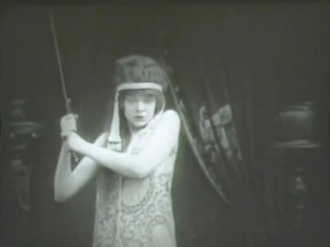 Judith (Blanche Sweet) prepares to behead Holofernes in Judith of Bethulia.