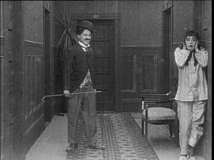 In Mabel's Strange Predicament, Dublin audiences saw Chaplin's tramp costume for the first time in a film whose comedy comes largely after Mabel locks herself out of her hotel room in her pajamas.