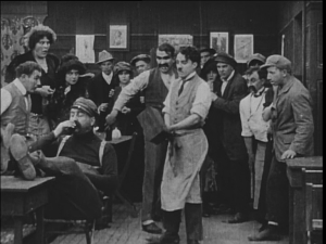 Chaplin prepares to deal with a difficult customer in Caught in a Cabaret.