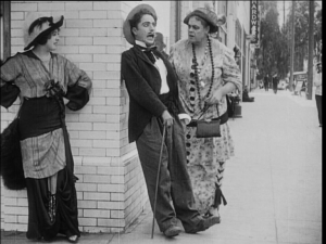 Charlie Chaplin, caught between Mabel Normand and Marie Dressler in Tillie's Punctured Romance (US: Keystone, 1914)