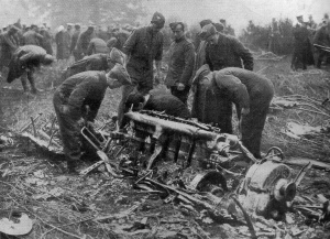 British military personnel sift through the wreckage of Airship SL11, shot down near Cuffley, Hertfordshire, on 3 September 1916. Image from Europeana.